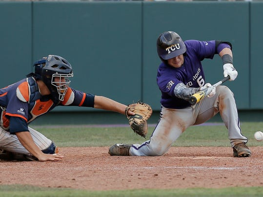 CORRECTS NAME OF CATCHER - Pepperdine catcherAaron Barnett, left, reaches for the ball as TCU's Kyle Bacak (6) makes contact for a sacrifice bunt to score teammate Jerrick Suiter, on what would be the game winning run, during the ninth inning of an NCAA college baseball tournament super regional game in Fort Worth, Texas, Monday, June 9, 2014. (AP Photo/Brandon Wade)