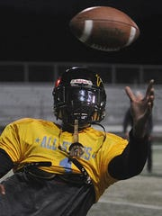 Grace Brethren wide receiver Noah Bean catches a pass during the East All-Stars practice at California Lutheran University. Bean will play for the University of Nevada Las Vegas in the fall.