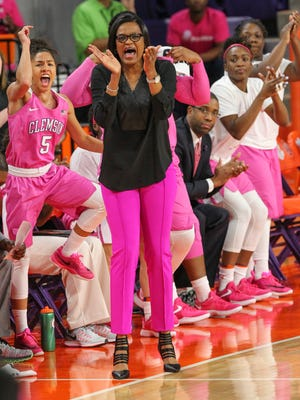 Clemson coach Audra Smith claps while players on the bench cheer during the fourth quarter of Clemson's Feb. 16 game against Notre Dame, which Clemson lost by only four points.