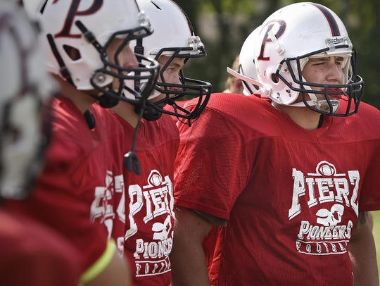 Pierz players gather in a huddle during practice Aug.