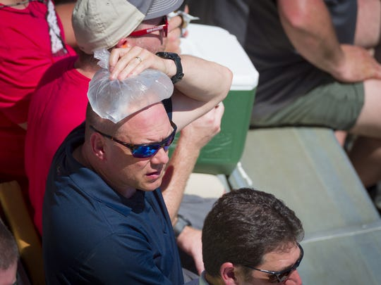Race fans sitting in the direct heat of the sun had to work to stay cool before the start of the Indianapolis 500 at Indianapolis Motor Speedway on Sunday, May 27, 2018.