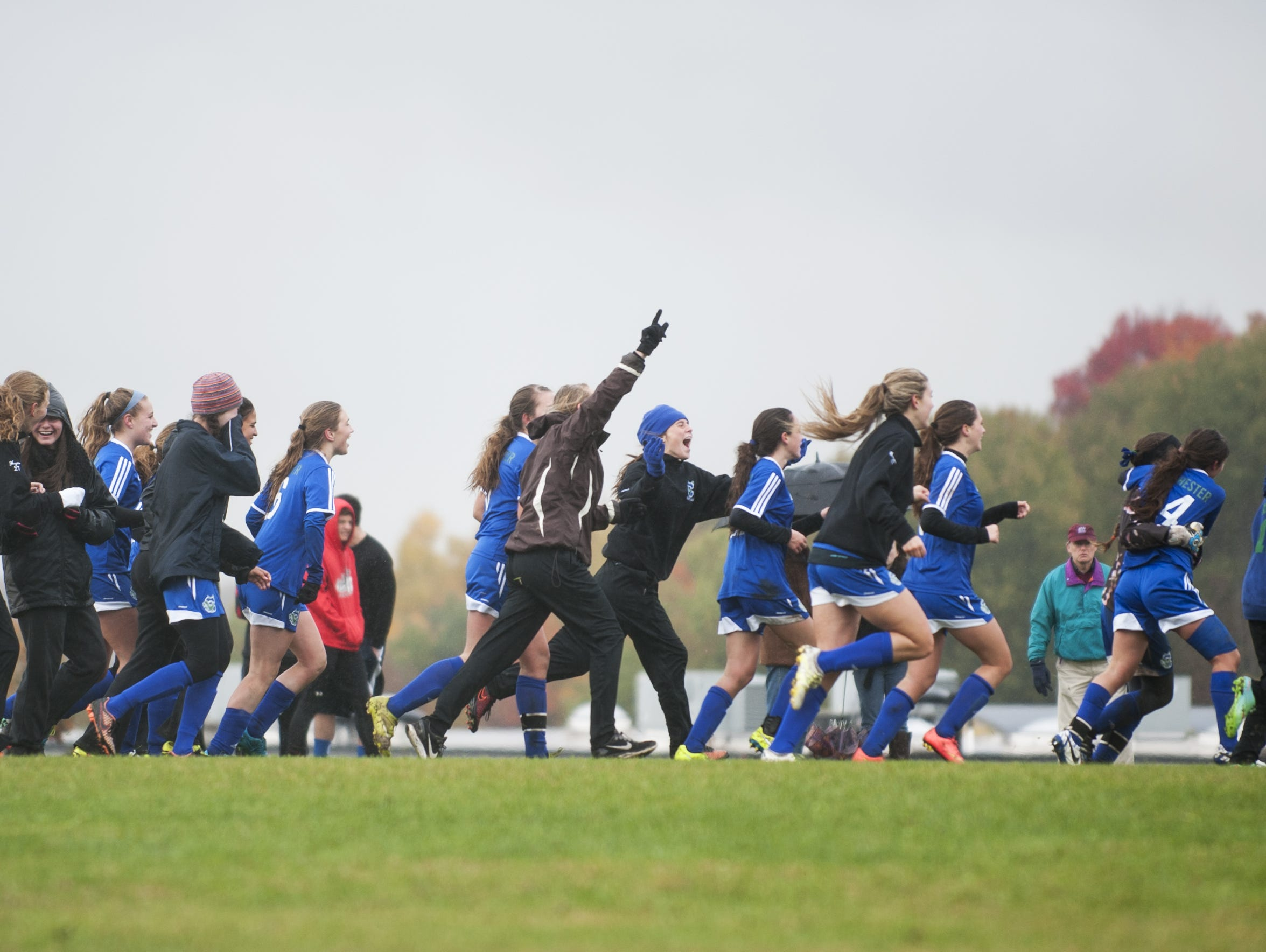 Colchester celebrates the game-winning goal in double overtime during a high school girls soccer game against Saturday.