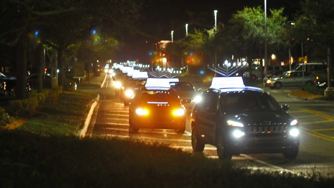 The Chabad of the Space and Treasure Coast held a Menorah parade that began at their temple in Satellite beach, and ended at the Avenue Viera, for the lighting of the Menorah for Hanukkah.
