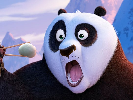Po (voiced by Jack Black)  inhales a dumpling in 'Kung