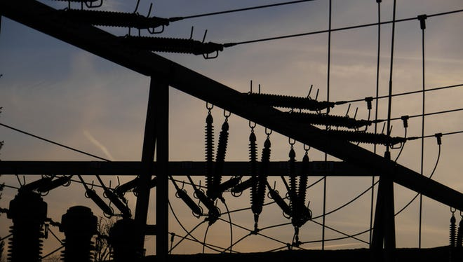 Electrical power grid in silhouette.