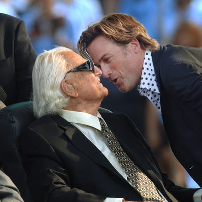 The Rev. Billy Graham is greeted by singer Michael