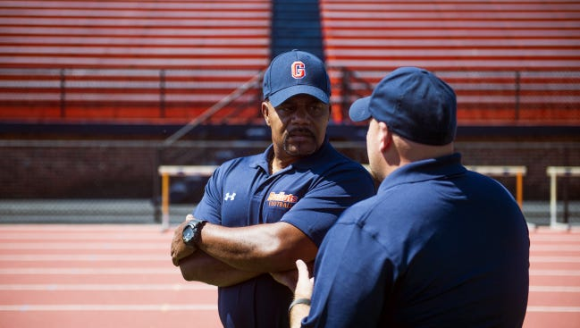 Gettysburg College's speed coach Kirby Scott speaks with coaching staff Saturday during a media day at Musselman Stadium at Gettysburg College.  Scott, a former Bullet, was named an All-American by the Associated Press in 1976 after posting a then-Gettysburg record 932 rushing yards and six touchdowns.