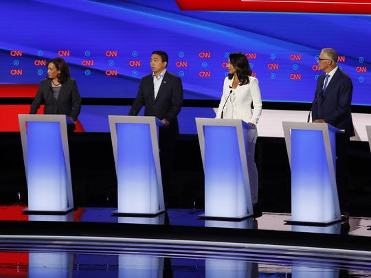 From left, former Vice President Joe Biden Sen. Kamala Harris, D-Calif., Andrew Yang, Rep. Tulsi Gabbard, D-Hawaii, Washington Gov. Jay Inslee and New York City Mayor Bill de Blasio participate in the second of two Democratic presidential primary debates hosted by CNN Wednesday, July 31, 2019, in the Fox Theatre in Detroit. (AP Photo/Paul Sancya)