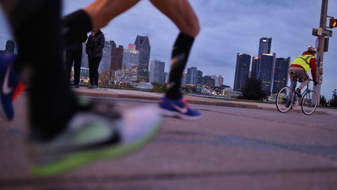 Downtown Detroit is seen as participants run along the Detroit River in Windsor, ON during the 38th Annual Detroit Free Press/Talmer Bank Marathon on Sunday, Oct. 18, 2015.