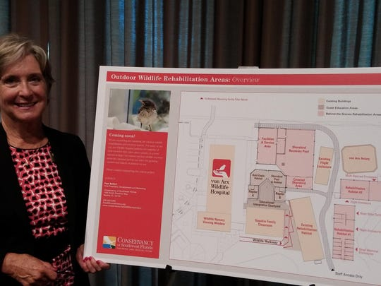 Lynn Slabaugh, chairwoman of the board for The Conservancy of Southwest Florida, stands by the plans for the new rehabilitation facilities. The new buildings are colored in pink.