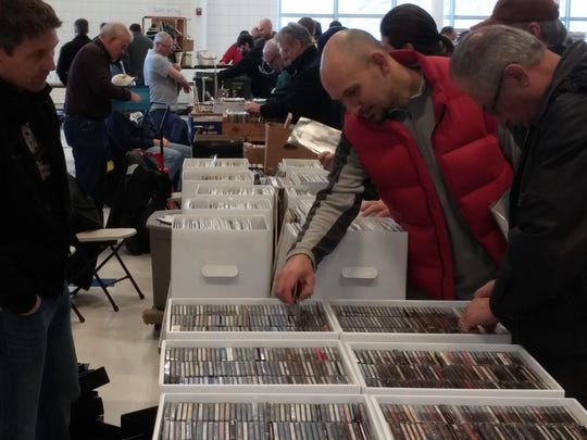 Music lovers look through hundreds of CDs at the record show.