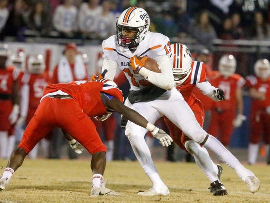 Blackman's Trey Knox (13) runs the ball as Oakland's
