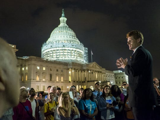 Rep. Joe Kennedy III, D-Mass., speaks outside the U.S.