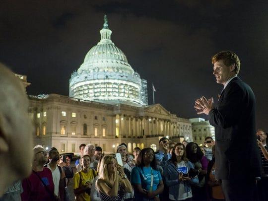 Rep. Joe Kennedy III, D-Mass., speaks outside the U.S.
