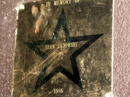 A star with Sean Sadowski's name on it is mounted on the wall inside the Ken Collins Theater at McNary High School in Keizer, Ore. Sadowski was a theater student at the school and was killed in a car accident in 1986. Pictured Friday October 25, 2002.