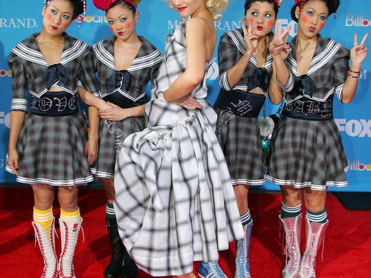 """Gwen Stefani poses with four """"Harajuku girls"""" on the"""