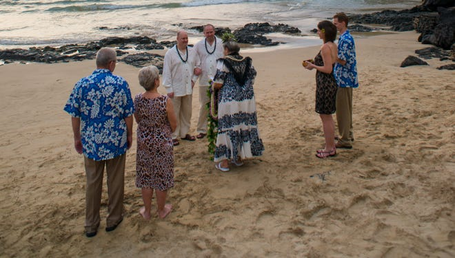 David Gibson and Michael Paris of Apex, N.C., are married on the Big Island's Mauna Kea Beach on Dec. 30. They waited to get married until Hawaii legalized same sex weddings.