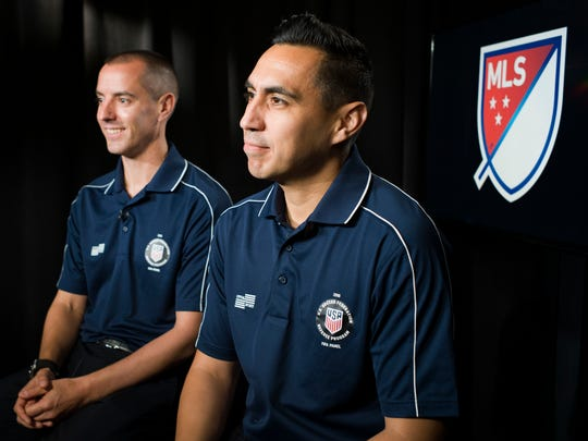 In this May 16, 2018 photo American soccer referees Mark Geiger, left, and Jair Marrufo are interviewed in New York. While the United States is missing from soccer's showcase for the first time since 1986, it is the only nation with two referees working the tournament. Geiger will become the second American to referee at two World Cups. The 43-year-old from Beachwood, New Jersey, worked Chile-Spain and Colombia-Greece during the group stage in Brazil four years ago, then became the first American to work a knockout stage match. Marrufo will be working his first World Cup after getting cut in 2010. (AP Photo/Mark Lennihan)