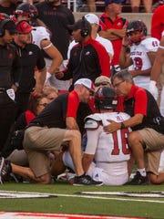 The Southern Utah training staff examine quarterback McCoy Hill (16) during the first quarter of Thursday's game against Utah in Salt Lake City, Sept. 1, 2016.