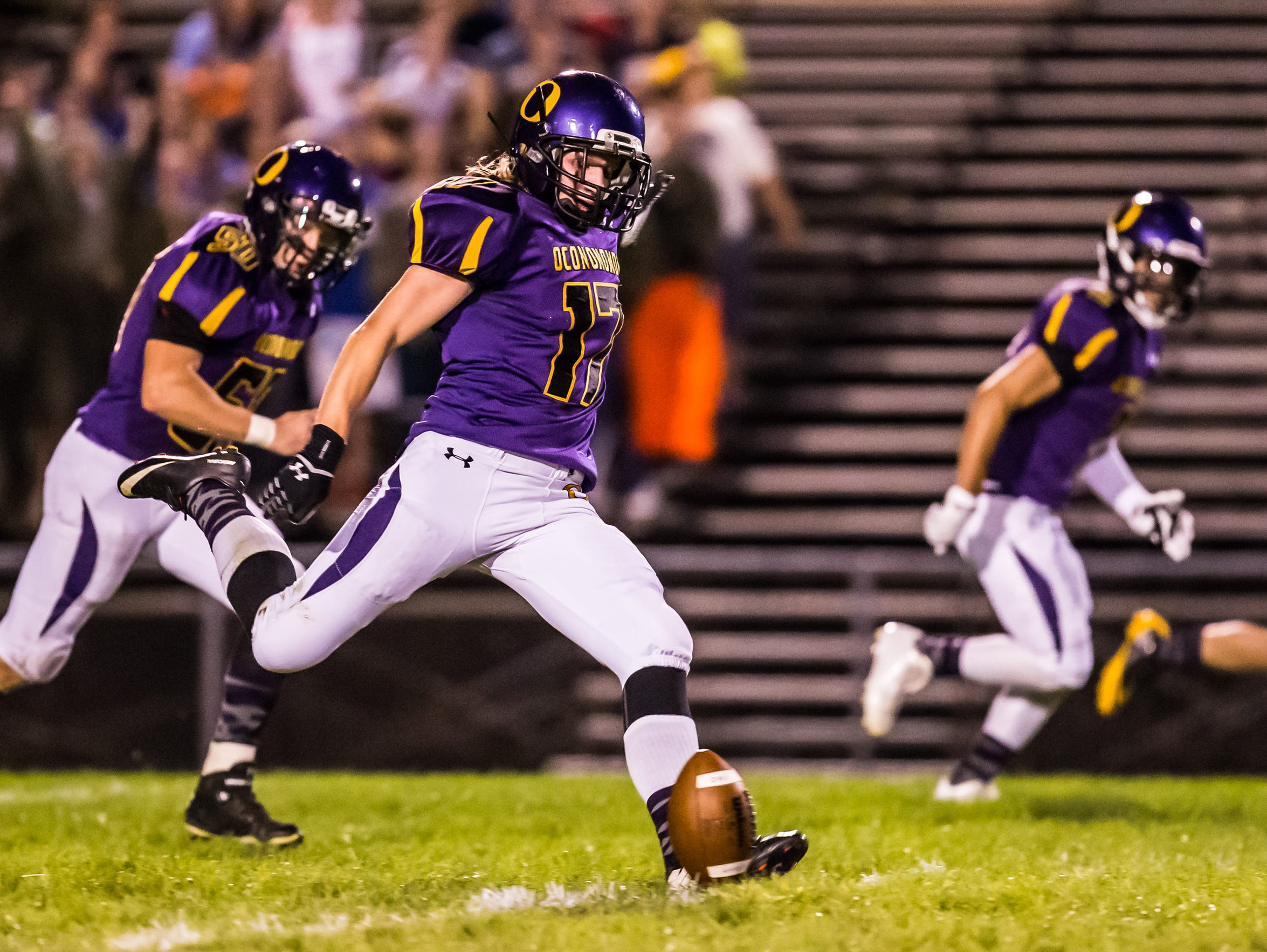 Oconomowoc kicker Casey Bednarski (17) kicks off during