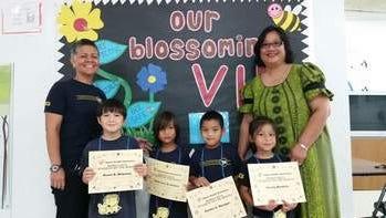 From left: Principal Hannah Gutierrez, Xavier Molyneux, Tomas Duenas, Dondre Mesngon, Lily Bordallo and Assistant Principal Eileen Gofigan