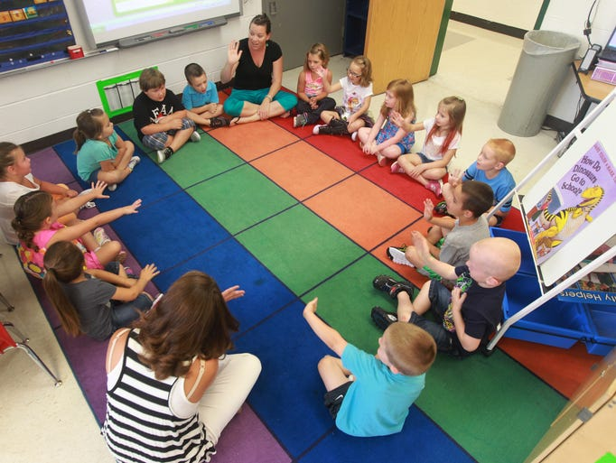 Silver Grove Schools kindergartners in Megan Schultz's class wave to one another as they introduce themselves.