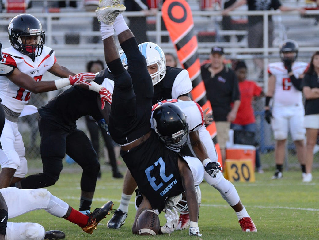 Rockledge Raider Vaurice Griffin Jr is upended in the opening kickoff Friday night in their home game against the Palm Bay Pirates.