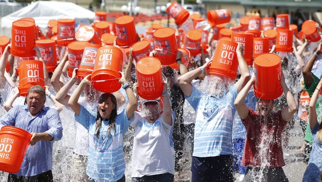 Participants get soaked in the annual Ice Bucket Challenge at Empire City Casino in Yonkers on Sunday, Aug. 7, 2016. The event raises funds for ALS research and has Yonkers roots.