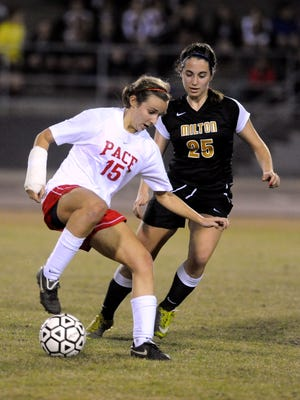 Pace High School's Mary Kathryn Taylor (15) puts some moves on Milton's Jenny Gillespie (25) during a 1-5A girls soccer tournament in Navarre.