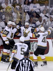 The Las Vegas Golden Knights celebrate after Tomas