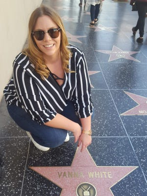 Alexandria Gallager poses with Vanna White's star on Hollywood Walk of Fame.