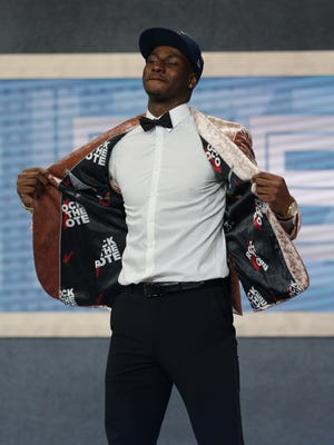 Jaren Jackson Jr. from Michigan State shows off the inside of his jacket after being selected as the No. 4 overall pick by the Grizzlies in this year's NBA draft.