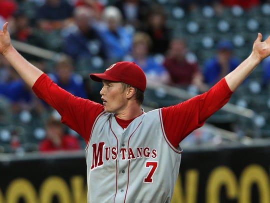Dallas Center - Grimes' pitcher #7 Tyler Peyton throws