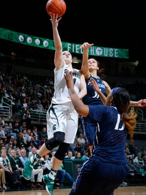 Michigan State's Tori Jankoska, left, gets a layup against Penn State's Jaida Travascio-Green, right rear, and Kaliyah Mitchell in the closing moments of the game to ice the win Wednesday, Feb. 22, 2017, in East Lansing, Mich. Michigan State won 73-64.