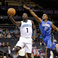 Charlotte Hornets' Lance Stephenson (1) drives past Orlando Magic's Maurice Harkless (21) during the first half of a preseason NBA basketball game in Charlotte in October.