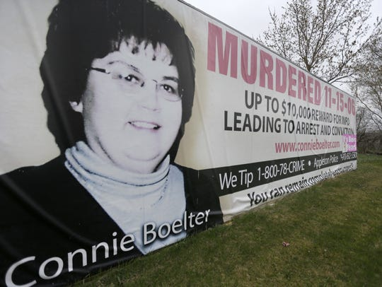 A billboard along State Highway 15 asks for information