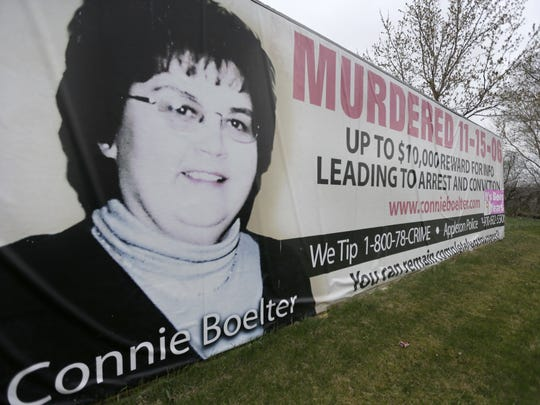 A billboard along State Highway 15 asks for information on the unsolved homicide of Connie Boelter.