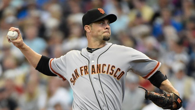 Ryan Vogelsong pitches in the first inning at Miller Park.