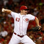 Cincinnati Reds relief pitcher Sam LeCure throws against the Washington Nationals during a baseball game, Friday, July 25, 2014, in Cincinnati.