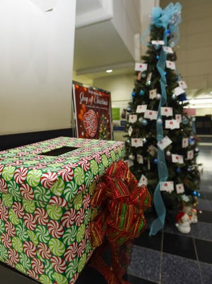 An adoption card copy drop box is located next to the Sugar Plum Tree and Bank of Hawaii Christmas tree in Hagåtña on Oct. 16, 2017.