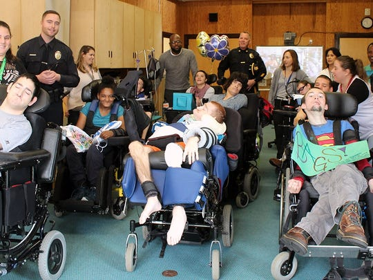 Members of the Middlesex Borough Police Department receive Brave Bags from residents of Matheny Education and Medical Center to comfort children in crisis.