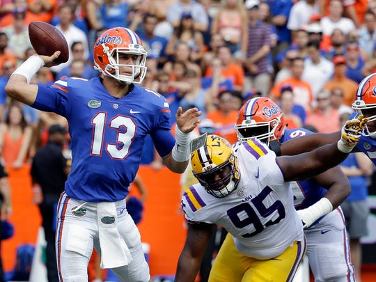 Florida quarterback Feleipe Franks (13) throws a pass