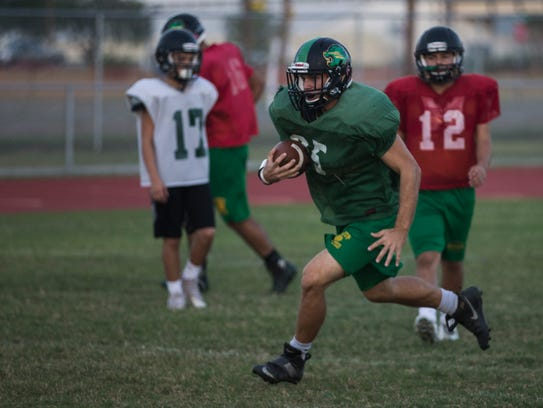 Bishop's Conner Bowers rushes the ball during practice