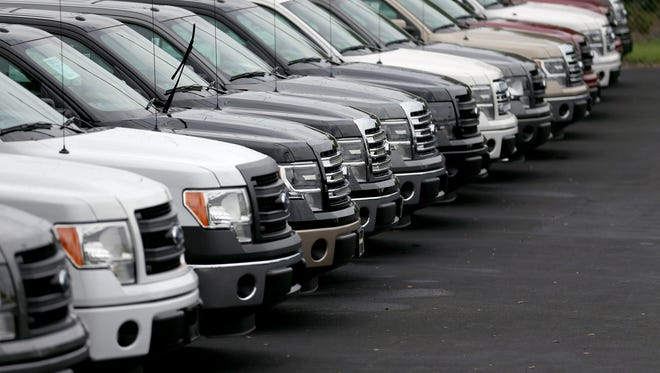 Ford F-150 trucks are seen on the sales lot at AutoNation Ford Miami on October 24, 2013 in North Miami, Florida.