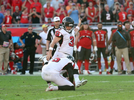 Dec 30, 2018; Tampa, FL, USA; Atlanta Falcons kicker Matt Bryant (3) kicks the game winning 37-yard field goal as Atlanta Falcons punter Matt Bosher (5) holds the ball against the Tampa Bay Buccaneers as time expires to end the game at Raymond James Stadium. Mandatory Credit: Kim Klement-USA TODAY Sports