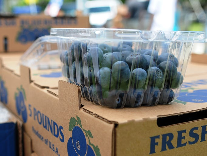 A case of fresh blueberries from Lyman, Miss. rests on a box during the annual Blueberry Jubilee in Poplarville.