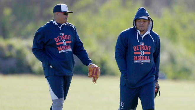 Detroit Tigers pitchers Alfredo Simon, left, and Bruce Rondon talk as they leave the practice field at spring training on Thursday, Feb. 19, 2015, in Lakeland, Fla.