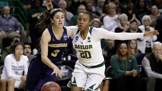 Michigan's Katelynn Flaherty drives to the basket past Baylor's Juicy Landrum in the first half Sunday.