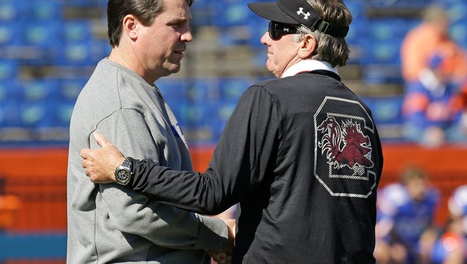 Florida head coach Will Muschamp , left, and South Carolina head coach Steve Spurrier greet each other on the field prior to an NCAA college football game in Gainesville, Fla., Saturday, Nov. 15, 2014. (AP Photo/John Raoux)