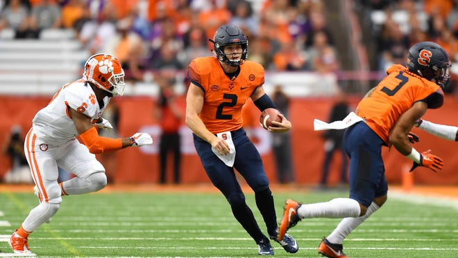 Syracuse Orange quarterback Eric Dungey (2) runs with the ball as Clemson Tigers linebacker Dorian O'Daniel (6) defends during the first quarter at the Carrier Dome. Mandatory Credit: Rich Barnes-USA TODAY Sports